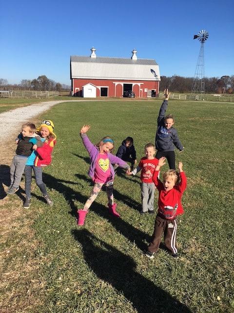 children by a barn