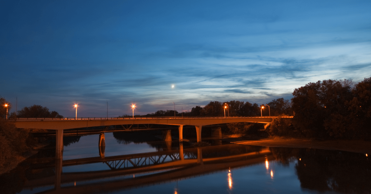 bridge over a river lit up for night